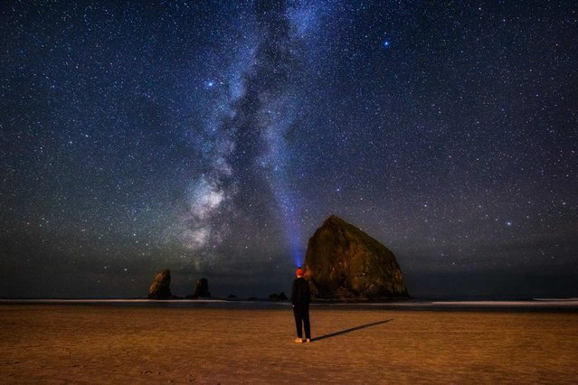 Michael Matti submitted this portrait of himself staring at the Milky Way over Cannon Beach, Oregon, to the online Your Shot community on November 13. When Matti went down to the beach after sunset on October 4, the clear sky and a new moon allowed him to capture this ethereal view of the galaxy. (Photo by Michael Matti/National Geographic)
