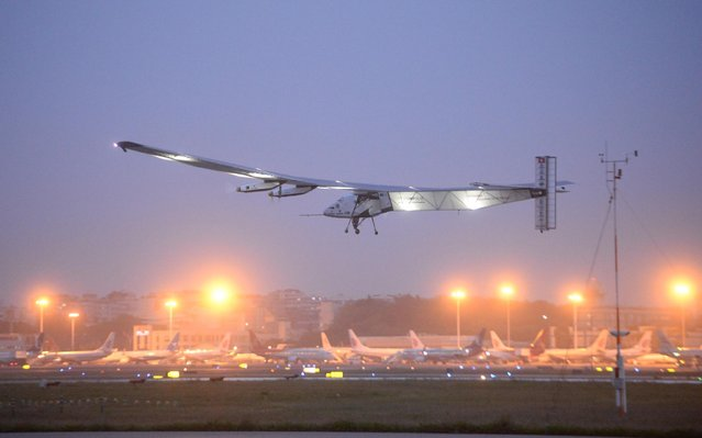A solar-powered plane takes off from Jiangbei International Airport in southwest China's Chongqing Municipality, Tuesday, April 21, 2015. The Solar Impulse 2 departed Chongqing on Tuesday for a 1190-kilometer (642-mile) flight to the city of Nanjing in eastern China, the sixth leg of its around-the-world flight. (Photo by Chinatopix via AP Photo)