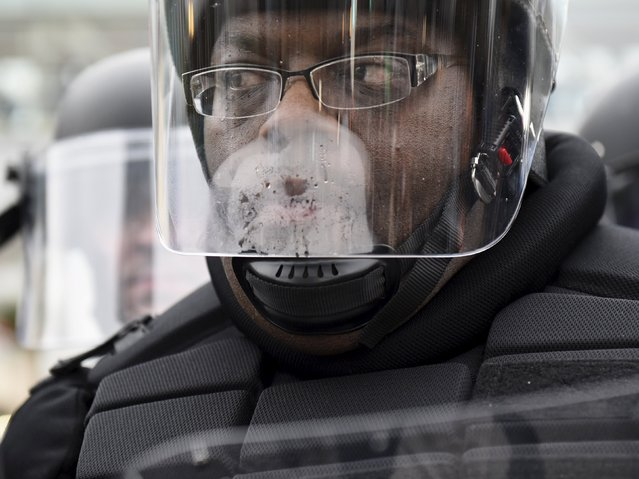 A policeman looks on as demonstrators gather near Camden Yards to protest against the death in police custody of Freddie Gray in Baltimore April 25, 2015. (Photo by Sait Serkan Gurbuz/Reuters)