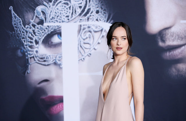"""Cast member Dakota Johnson poses at the premiere of the film """"Fifty Shades Darker"""" in Los Angeles, California, February 2, 2017. (Photo by Danny Moloshok/Reuters)"""