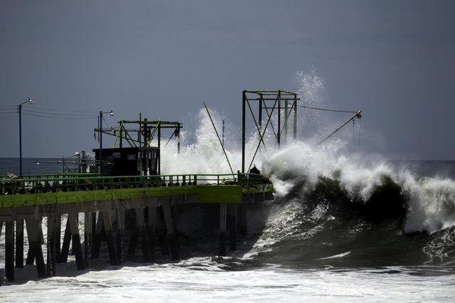 A wave crashes on a fishing dock at La Libertad May 3, 2015. (Photo by Jose Cabezas/Reuters)
