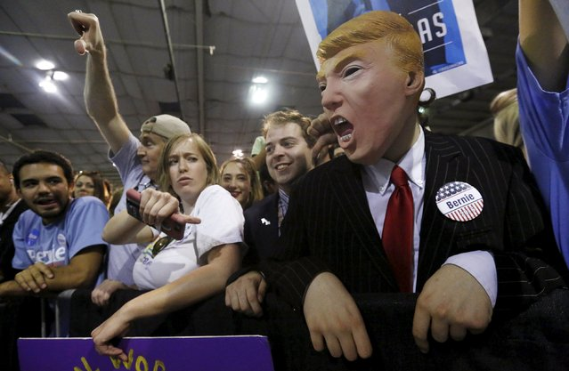 A supporter wears a mask depicting Republican U.S. presidential candidate Donald Trump during a campaign rally by Democratic U.S. presidential candidate Bernie Sanders in Phoenix, Arizona March 19, 2016. (Photo by Mario Anzuoni/Reuters)