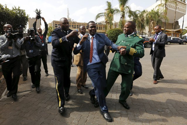 Kenyan Member of Parliament for Ugujna Constituency Opiyo Wandayi (C) is ejected from the National Assembly for blowing whistles during President Uhuru Kenyatta's annual State of the Nation address at the Parliament Buildings in the capital Nairobi, March 31, 2016. (Photo by Thomas Mukoya/Reuters)