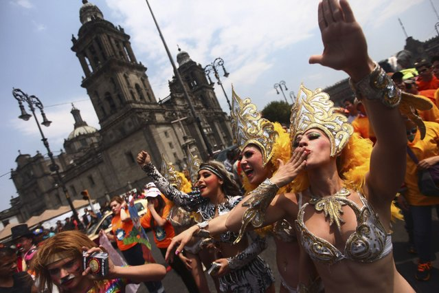 Circus dancers gesture during a demonstration in support of the use of animals in circus shows, in front of the Metropolitan Cathedral in Mexico City, on March 13, 2014. (Photo by Edgard Garrido/Reuters)