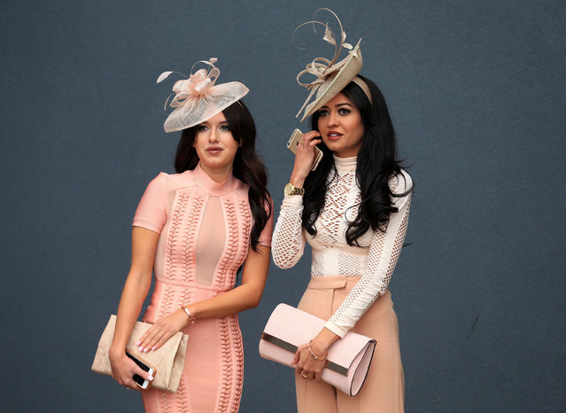 From salmon pink to rose gold: racegoers attends Ladies Day of the Crabbie's Grand National Festival at Aintree Racecourse on April 8, 2015 in Liverpool, England. (Photo by Mike Egerton/PA Wire)
