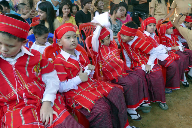 Children with autism sit, during a ceremony to mark World Autism Awareness Day organized by Myanmar Autism Association at public square, in Yangon, Myanmar, Thursday, April 2, 2015. (Photo by Khin Maung Win/AP Photo)