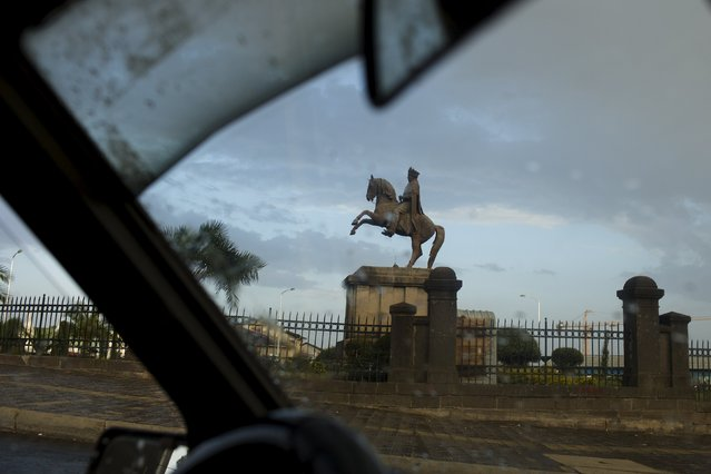 A statue of King Menelik II, the founder of Addis Ababa, is seen through the front windscreen of a taxi, in the capital Addis Ababa, Ethiopia, May 17, 2015. (Photo by Siegfried Modola/Reuters)