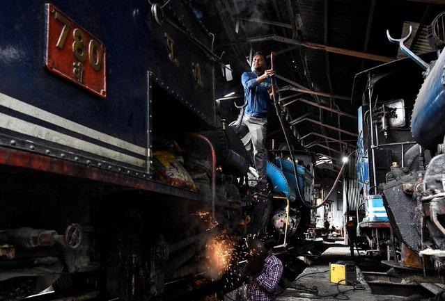 Workers repair a steam engine belonging to Darjeeling Himalayan Railway, which runs on a 2 foot gauge railway and is a UNESCO World Heritage Site, at a workshop in Darjeeling, India, June 24, 2019. (Photo by Ranita Roy/Reuters)