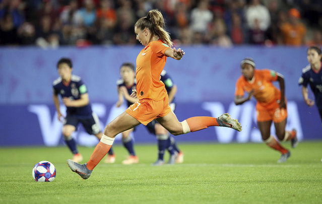 Netherlands' Lieke Martens scores her side's second goal from the penalty spot during the Women's World Cup round of 16 soccer match between the Netherlands and Japan at the Roazhon Park, in Rennes, France, Tuesday, June 25, 2019. (Photo by David Vincent/AP Photo)