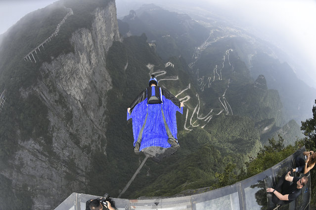 A wingsuit flier takes part in a test flight ahead of 2019 World Wingsuit League (WWL) China Grand Prix at Tianmen Mountain on September 3, 2019 in Zhangjiajie, Hunan Province of China. Sixteen wingsuit fliers from 11 countries will participate in the 2019 World Wingsuit League (WWL) China Grand Prix in Zhangjiajie on September 5-8. (Photo by Shao Ying/VCG via Getty Images)