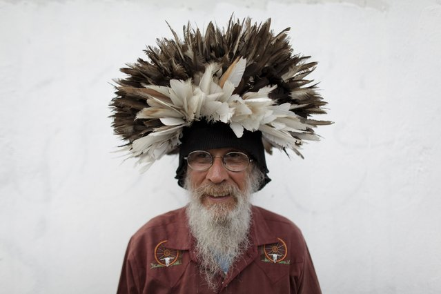 Jesus Moreno, 60, poses for a photograph with a wig made with pigeon feathers in downtown Monterrey, Mexico July 7, 2015. (Photo by Daniel Becerril/Reuters)