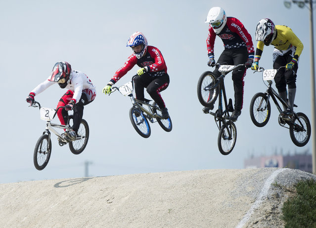 Canadian Tory Nyhaug, left, leads the pack over a jump during men's BMX finals at the Pan American Games in Toronto, Saturday, July 11, 2015. Nyhaug went on the win gold. (Photo by Nathan Denette/Canadian Press via AP Photo)