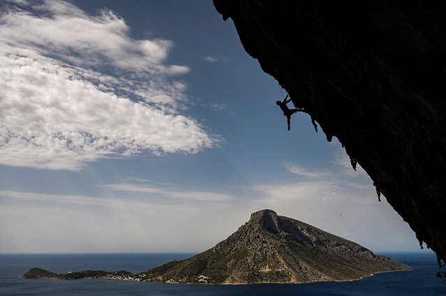 A climber participates in the 2019 annual Climbing Festival in the island of Kalymnos on October 4, 2019. The festival has attracted some 400 sports climbers from across the globe. The geography, the breathtaking views and the great weather conditions have made the Greek island of Kalymnos a top destination for international rock climbers of all levels with more than 2500 climbing routes. (Photo by Aris Messinis/AFP Photo)