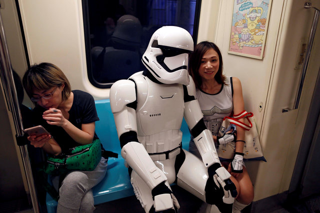 "A fan dressed as a Storm Trooper from ""Star Wars"" reacts at the Taipei Metro (MRT) during Star Wars Day in Taipei, Taiwan on May 4, 2017. (Photo by Tyrone Siu/Reuters)"