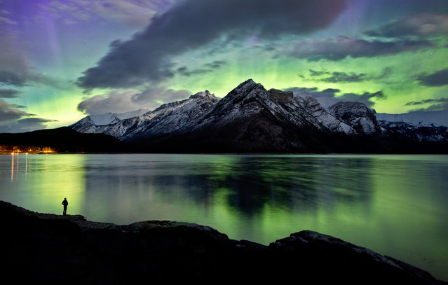 "Paul Zizka in ""Pillars In The Sky"", Lake Minnewanka, Banff National Park, May 26, 2013. (Photo by Paul Zizka/Caters News)"