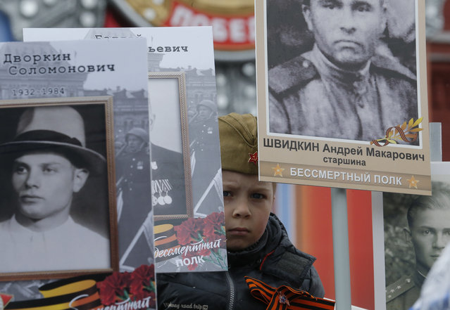 A boy attends the Immortal Regiment march during the 72nd anniversary of the end of World War II on the Red Square in Moscow, Russia on May 9, 2017. (Photo by Sergei Karpukhin/Reuters)