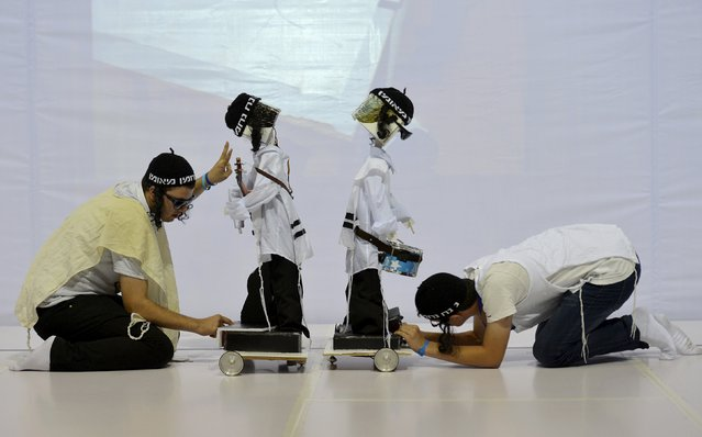 Participants test their robots playing musical instrument as they prepare for a competition during the RoboCup 2015, at an exhibition centre in Hefei, Anhui province, China, July 20, 2015. Over 2,000 people have registered to join the RoboCup in Hefei this year which will be held from July 19 to July 23, local media reported. (Photo by Reuters/Stringer)