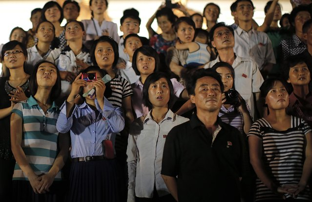 North Koreans watch as fireworks explode, Monday, July 27, 2015, in Pyongyang, North Korea as part of celebrations for the 62nd anniversary of the armistice that ended the Korean War. (Photo by Wong Maye-E/AP Photo)