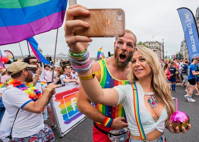 James Haskell and Chloe Madeley taking a selfie in front of the crowd  in the annual Pride Parade in London on July 6, 2019. (Photo by Guy Bell/Rex Features/Shutterstock)