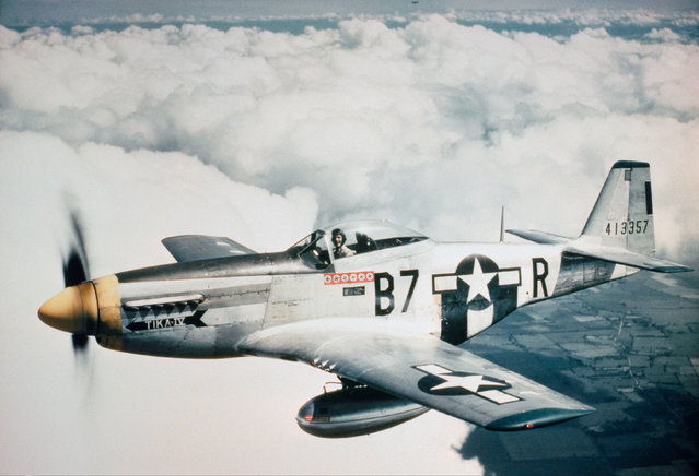 Lt Vernon R Richards of the 361st Fighter Group flying his P-51D Mustang nicknamed Tika IV during a bomber escort mission in 1944. (Photo by IWM/PA Wire)