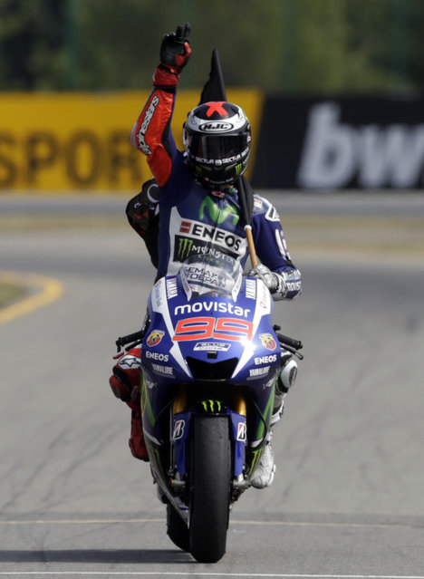 Winner Yamaha MotoGP rider Jorge Lorenzo of Spain reacts after winning the Czech Grand Prix in Brno, Czech Republic, August 16, 2015. (Photo by David W. Cerny/Reuters)