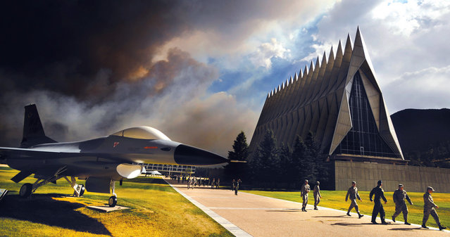 An ominous cloud of smoke from the Waldo Canyon fire rises from the south behind the Air Force Academy's Cadet Chapel as cadets head for a briefing on evacuation procedures in Colorado Springs, in this June 27, 2012 photograph. The Academy evacuated more than 600 families and 110 dormitory residents from the base the evening of June 27. (Reuters/Carol Lawrence/U.S. Air Force)