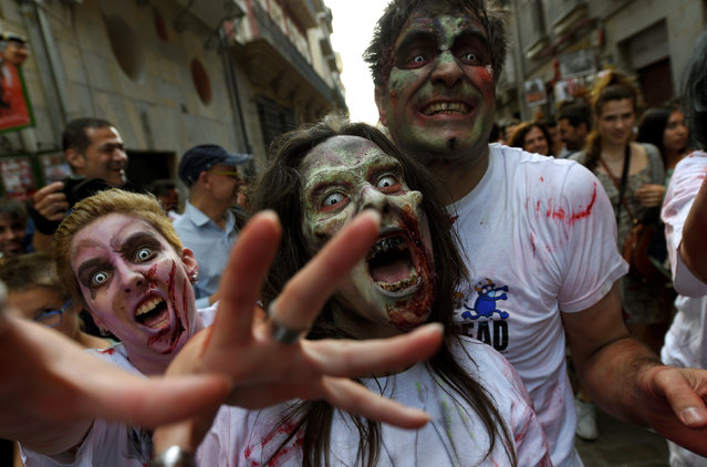 Revellers dressed as zombies take part in an enactment of the running of the bulls a day before the start of the San Fermin festival in Pamplona, northern Spain, July 5, 2016. (Photo by Eloy Alonso/Reuters)