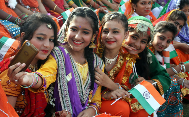 Indian school children take selfie picture as they perform cultural dance during the Independence Day celebrations in Jammu, the winter capital of Kashmir, India, 15 August 2017. (Photo by Jaipal Singh/EPA)