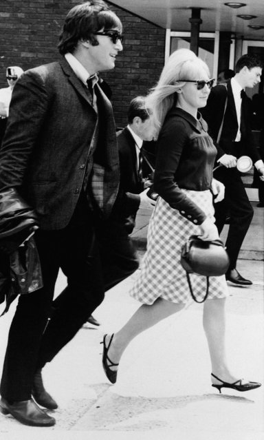 "In this July 2,1964 file photo, singer John Lennon and his then wife, Cynthia, at Luton airport after ""The Beatles"" arrived home from their three-week tour of Australia and New Zealand. Cynthia Lennon passed away on Thursday, April 1, 2015, aged 75, at her home in Mallorca, Spain, following a short but brave battle with cancer. (Photo by Victor Boynton/AP Photo)"