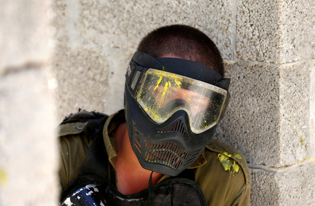 Paint is seen on the goggles of an Israeli soldier from the Nahal Infantry Brigade after he was hit by a paintball during an urban warfare training in the West Bank Jewish settlement of Alei Zahav, near Ariel July 13, 2016. (Photo by Baz Ratner/Reuters)