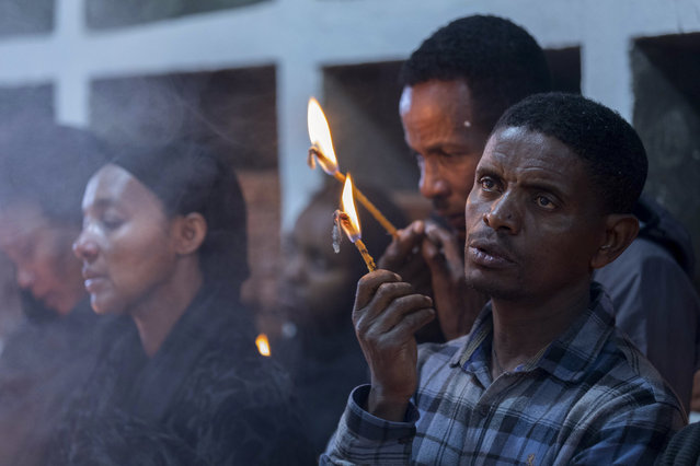 Ethiopian relatives of some of the crash victims light candles and gather at an anniversary memorial service to remember those who died when Ethiopian Airlines flight ET302, a Boeing 737 Max, crashed shortly after takeoff on March 10, 2019 killing all 157 on board, at the Holy Trinity Cathedral in Addis Ababa, Ethiopia Sunday, March 8, 2020. (Photo by Mulugeta Ayene/AP Photo)