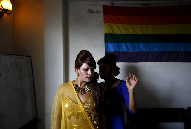A reveller gets ready to take part in a LGBT (lesbian, gay, bisexual, and transgender) pride parade to mark the Gaijatra Festival, also known as the festival of cows, in Kathmandu, Nepal August 30, 2015. (Photo by Navesh Chitrakar/Reuters)