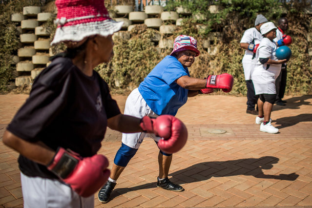 "The ""Boxing Gogos"" (Grannies) take part in a session hosted by the A Team Gym in Cosmo City in Johannesburg on September 19, 2017. (Photo by Gulshan Khan/AFP Photo)"