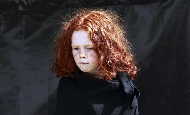 Maggie Noonan, 7, poses for a portrait during the Irish Redhead Convention in the village of Crosshaven in County Cork August 23, 2014. The annual festival which attracts people from all over the world celebrates people with red hair. (Photo by Cathal McNaughton/Reuters)
