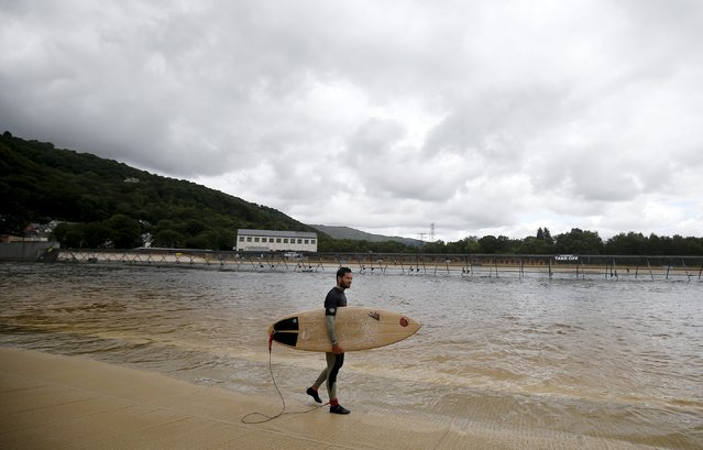 Surfers surf at Surf Snowdonia in Conwy, North Wales, September 3, 2015. The surf park, which cost $22.8 million, opened on August 1 and is the world's first commercial artificial surfing lake, according to the company.The pool is 300 metres (980 ft) long and 110 metres (360 ft) wide, containing a total of six million gallons of water. (Photo by Andrew Yates/Reuters)