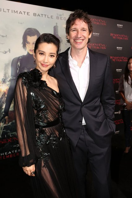 "Actress Li Bingbing and writer/director/producer Paul W.S. Anderson arrive at the Los Angeles premiere of ""Resident Evil: Retribution"" at Regal Cinemas L.A. Live on September 12, 2012 in Los Angeles, California. (Photo by Christopher Polk)"