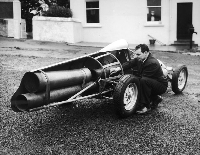 Mr. J. L. M. Meikle, a member of the 500 Motor Racing Club of Ireland at his him in Bangor, Wales, with a jet-propelled racing car that he has built. 10th January 1957 (Photo by MacMullan/Fox Photos)