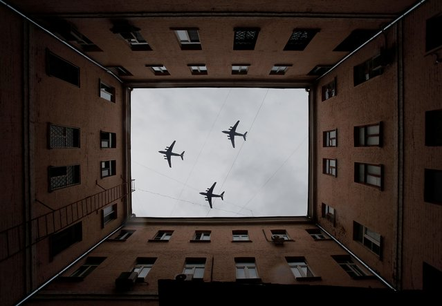 Russian Il-76 military transport aircrafts fly in formation during a rehearsal for the flypast, which marks the 75th anniversary of the victory over Nazi Germany in World War Two, in Moscow, Russia on May 4, 2020. The traditional large-scale Victory Day military parade across Red Square was postponed due to the outbreak of the coronavirus disease (COVID 19). (Photo by Maxim Shemetov/Reuters)