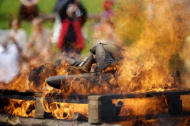 About 50 kilograms of rhino horns are being burned at the zoo in Dvur Kralove, Czech Republic, Sunday, September 21, 2014. During the symbolic event the zoo burned the horns to show clearly that the situation of rhinos in the wild is critical and that it is the demand for rhino horn what drives them towards extinction. (Photo by Petr David Josek/AP Photo)