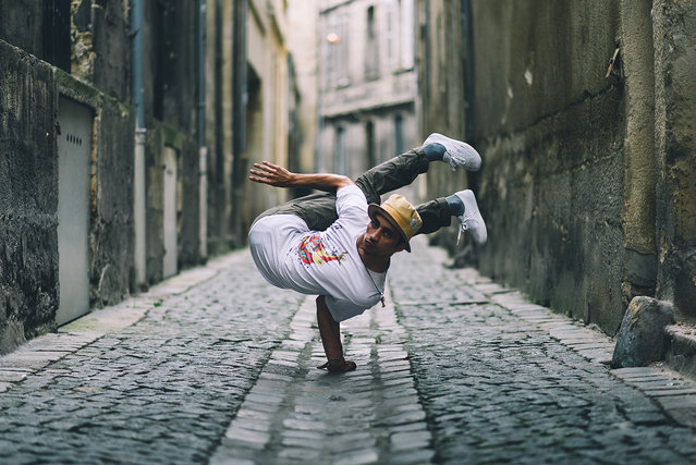 """""""Bboy for life"""". Amadou is a breakdancer for may years. He was preparing one of is biggest contest of his dancer life. As i followed him during some days over Bordeaux we took a moment to make this crazy flexible portrait. Photo location: France. (Photo and caption by William Kerdoncuff/National Geographic Photo Contest)"""