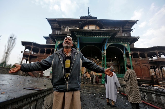 A man reacts after a fire damaged a portion of the shrine of Mir Syed Ali Hamdani, a Sufi saint, in Srinagar November 15, 2017. (Photo by Danish Ismail/Reuters)