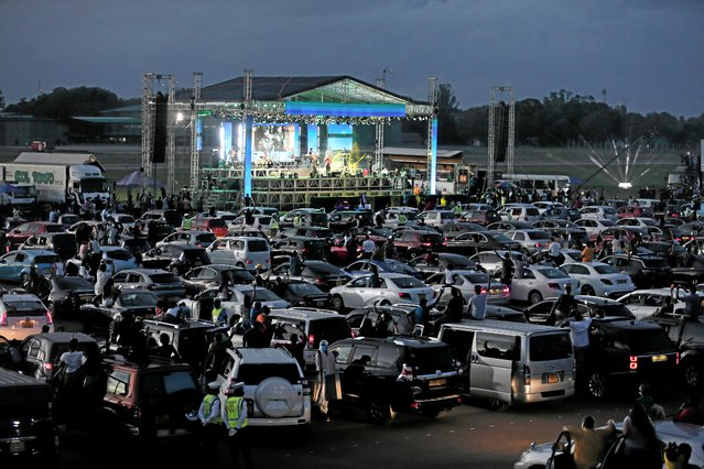 Vehicles are seen during the first drive-in concert, where fans can watch the events from inside their vehicles at an Airforce camp, after Island-wide day time curfew been lifted to restart the country's economic activities which is almost two months locked down amidst concerns about the spread of the coronavirus disease (COVID-19), in Colombo, Sri Lanka, May 30, 2020. (Photo by Dinuka Liyanawatte/Reuters)