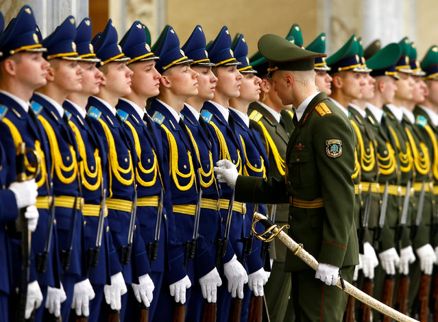 Members of the honor guard prepare before the meeting of Belarussian President Alexander Lukashenko with his Kazakh counterpart Nursultan Nazarbayev at the Independence Palace in Minsk, Belarus November 29, 2017. (Photo by Vasily Fedosenko/Reuters)