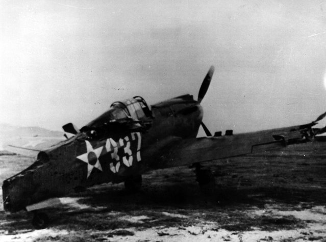 7th December 1941:  Following the surprise attack by the Japanese on Pearl Harbour (Pearl Harbor) this US Army P40 pursuit plane was machine gunned on the ground at Bellows Field by the enemy.  (Photo by Keystone/Getty Images)