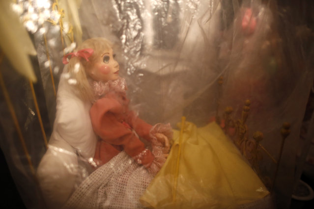 One of 2,000 marionettes lies in a storage area at the Bob Baker Marionette Theater in Los Angeles, California October 17, 2014. (Photo by Lucy Nicholson/Reuters)