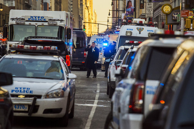 Police block a street by Port Authority Bus Terminal near New York's Times Square following an explosion on Monday, December 11, 2017. Police say the explosion happened in an underground passageway under 42nd Street between Seventh and Eighth Avenues. (Photo by Andres Kudacki/AP Photo)