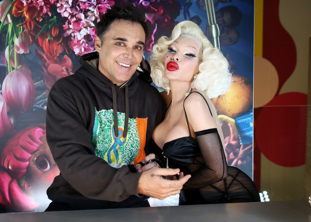 "Amanda Lepore (R) poses for a photo with photographer David LaChapelle when he signs copies of his new double-volume book ""Good News Part I"" and ""Lost + Found Part II"" at TASCHEN on December 14, 2017 in New York City. (Photo by Monica Schipper/Getty Images)"