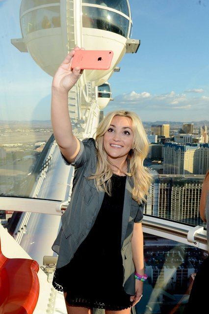 Actress/singer Jamie Lynn Spears takes a selfie photograph during her ride on The High Roller, the world's tallest observation wheel. At The Linq on July 14, 2014 in Las Vegas, Nevada. (Photo by Denise Truscello/WireImage)
