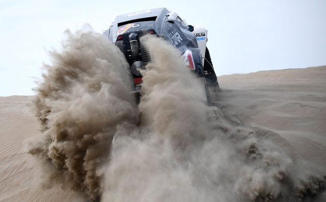 SsangYong' s Spanish driver Oscar Fuertes and co- driver Diego Vallejo compete during the 2018 Dakar Rally Stage 2 in and around the Peruvian town of Pisco, on January 7, 2018. (Photo by Franck Fife/AFP Photo)