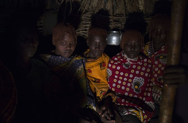 Pokot girls sit inside a hut during their circumcision ceremony, about 80 kilometres from the town of Marigat in Baringo County, October 16, 2014. (Photo by Siegfried Modola/Reuters)